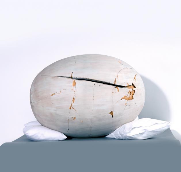 這個赤土陶器經修復後,外觀回復至原狀的八至九成。