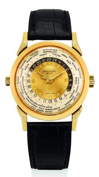 百達翡麗,型號2523 18K黃金腕錶,配世界時間,「Two-crown world time」,1953年製。 成交額$22,300,000港元,創亞洲拍賣紀錄。